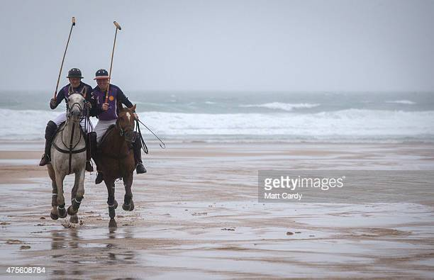 Polo players Andy Burgess riding Tonka and Daniel Loe and riding brown horse La Sophia practice for the annual beach polo competition being held on...