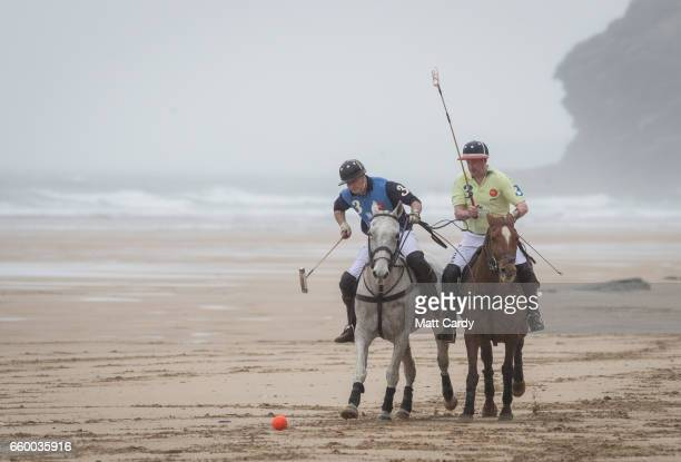 Polo players Andy Burgess riding Tonka and Daniel Loe riding La Sofia practice for the forthcoming Aspall Polo on the Beach at Watergate Bay on March...