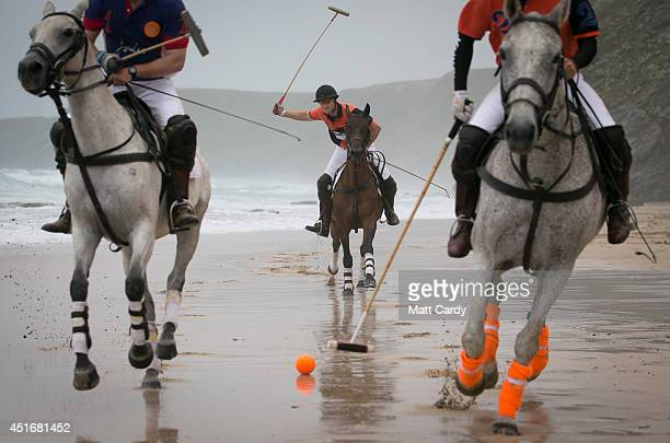 Polo players Andy Burgess riding Tonka Rob Brockett riding Torda and Ben Marshall riding Shriva practice for the beach polo competition being held on...