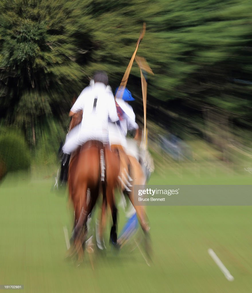 Polo players from Team Mercedes play against the Caballeros Polo Team in Bethpage State Park on September 9, 2012 in Bethpage, New York.