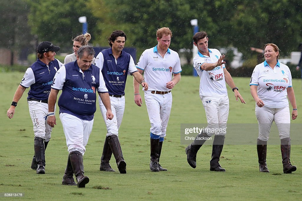 Polo players, including Royal Salute World Polo Ambassador Malcolm Borwick, <a gi-track='captionPersonalityLinkClicked' href=/galleries/search?phrase=Prince+Harry&family=editorial&specificpeople=178173 ng-click='$event.stopPropagation()'>Prince Harry</a>, and Argentine player <a gi-track='captionPersonalityLinkClicked' href=/galleries/search?phrase=Nacho+Figueras&family=editorial&specificpeople=2308997 ng-click='$event.stopPropagation()'>Nacho Figueras</a>, walk off the pitch after competing during the Sentebale Royal Salute Polo Cup in Palm Beach at Valiente Polo Farm on May 4, 2016 in Palm Beach, United. The event will raise money for <a gi-track='captionPersonalityLinkClicked' href=/galleries/search?phrase=Prince+Harry&family=editorial&specificpeople=178173 ng-click='$event.stopPropagation()'>Prince Harry</a>'s charity Sentebale, which supports vulnerable children and young people living with HIV in Lesotho in southern Africa.