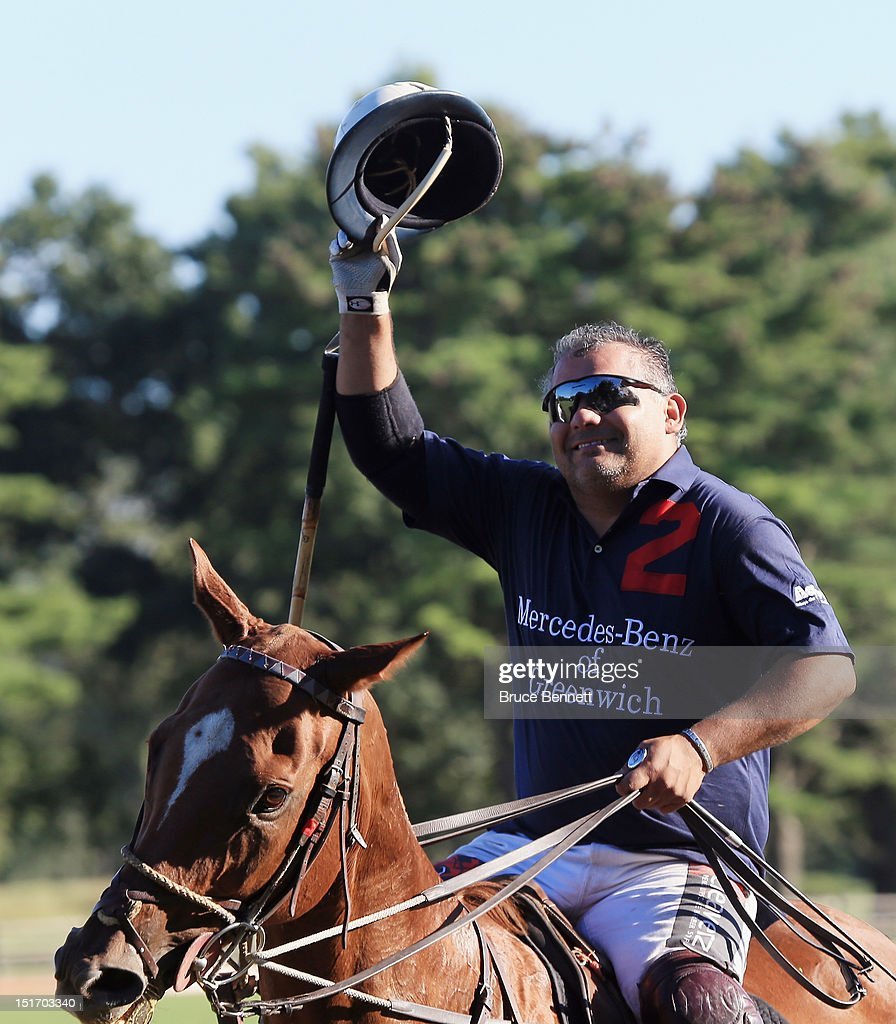 Polo players salute fans following the game between Team Mercedes and the Caballeros Polo Team in Bethpage State Park on September 9, 2012 in Bethpage, New York.