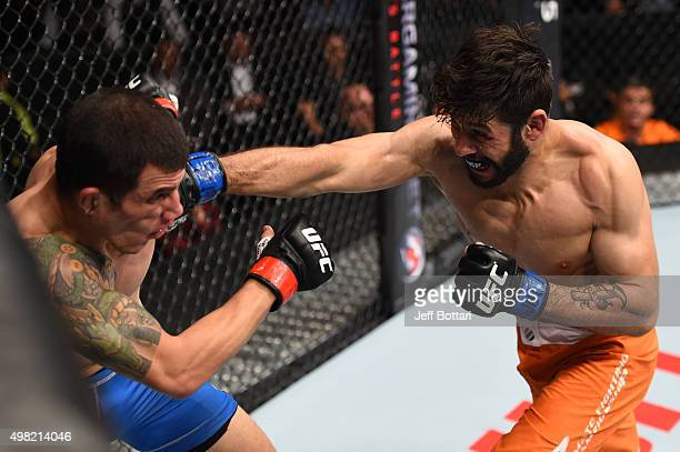Polo Reyes of Mexico punches Cesar Arzamendia of Paraguay in their lightweight bout during the UFC Fight Night event at Arena Monterrey on November...