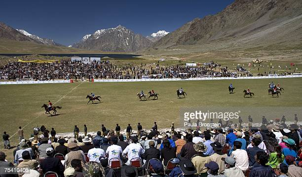 Polo team players Chitral and Gilgit charge down the field during the annual Shandur Polo Festival July 9 2007 on Shandur pass in Pakistan The three...