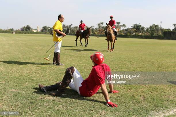 Polo teams play in polo field near the Saqqara pyramids on December 06 2013 in Cairo Egypt There are a few polo teams in Egypt connected with...