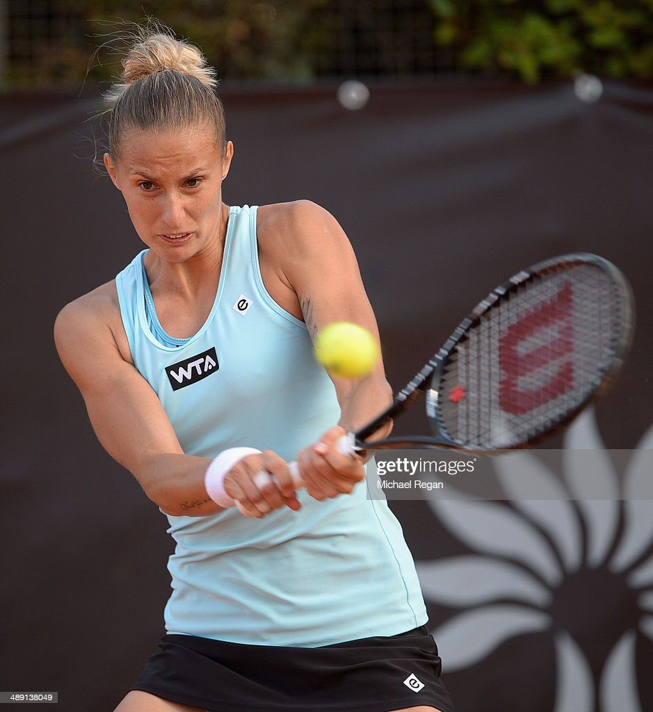 <a gi-track='captionPersonalityLinkClicked' href=/galleries/search?phrase=Polona+Hercog&family=editorial&specificpeople=4315683 ng-click='$event.stopPropagation()'>Polona Hercog</a> of Slovenia plays a shot against Belinda Bencic of Switzerland during qualifying for the Internazionali BNL d'Italia 2014 on May 10, 2014 in Rome, Italy.