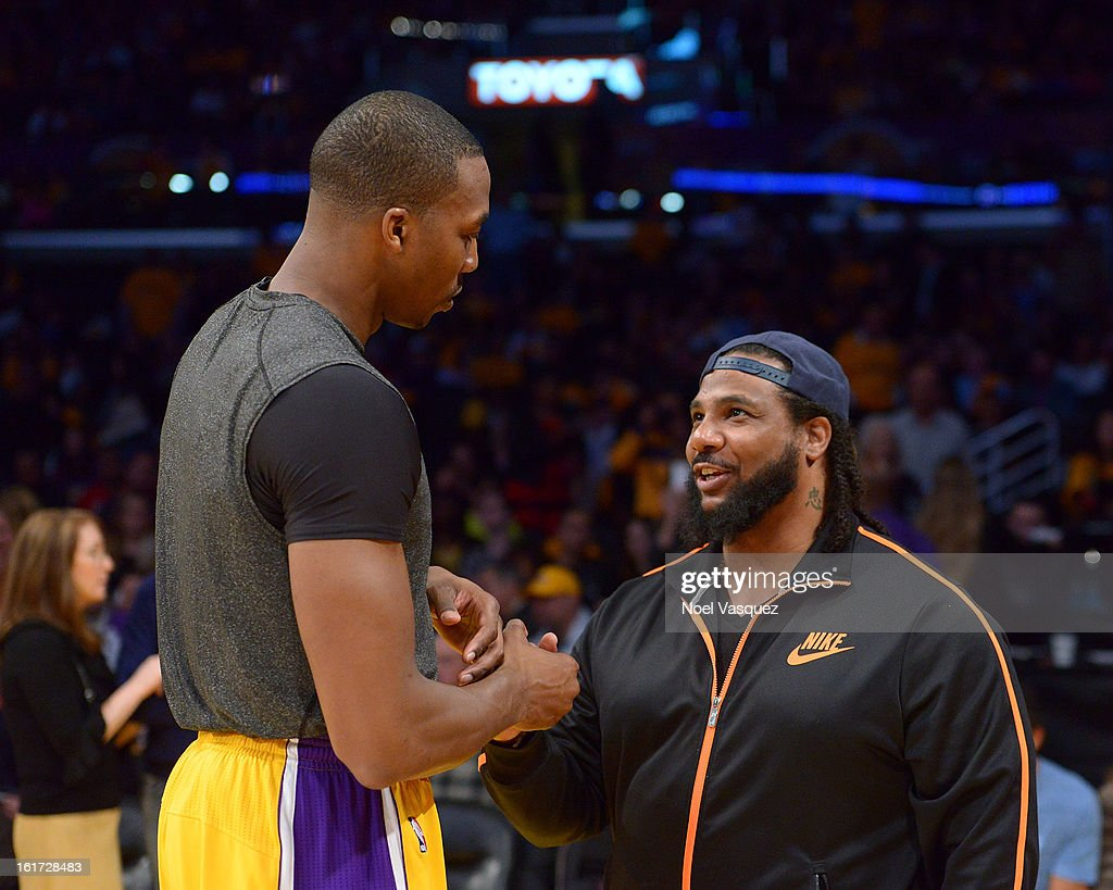 Polow da Don (R) talks to <a gi-track='captionPersonalityLinkClicked' href=/galleries/search?phrase=Dwight+Howard&family=editorial&specificpeople=201570 ng-click='$event.stopPropagation()'>Dwight Howard</a> at a basketball game between the Los Angeles Clippers and the Los Angeles Lakers at Staples Center on February 14, 2013 in Los Angeles, California.