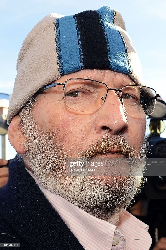 Poly Implant Prothese (PIP) boss Jean-Claude Mas (C) looks on as he leaves the jail of Avignon Le Pontet after a French judge ordered his release, on October 29, 2012 in Le Pontet, southern France. Mas, 73, was ordered released but will be 'placed under judicial supervision,' his lawyer Yves Haddad said, adding that he would be freed later today.Between 400,000 and 500,000 women around the world are believed to have received allegedly faulty breast implants made by PIP, the now-defunct company that Mas founded in southern France, as French doctors have registered 20 cases of cancer among women fitted with the implants. AFP PHOTO / BORIS HORVAT