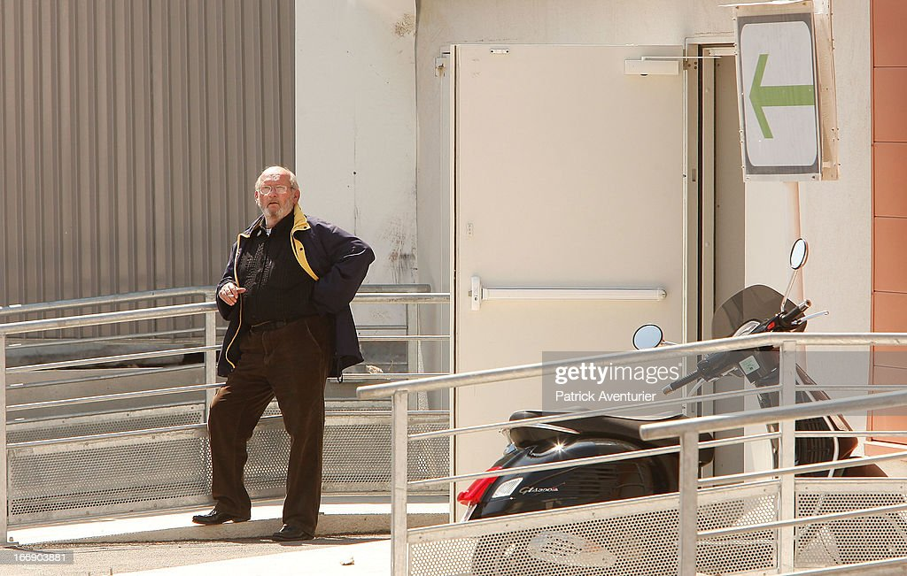Poly Implant Prothese founder and CEO, Jean-Claude Mas, waits outside the courthouse at Parc Chanot on April 18, 2013 in Marseille, France. Jean-Claude Mass and his PIP company are facing fraud charges for allegedly selling 30 000 faulty breast implants in France with non-autorised silicone gel that caused abnormally high rupture rates of its implants. 5200 women have filed complaints against PIP.