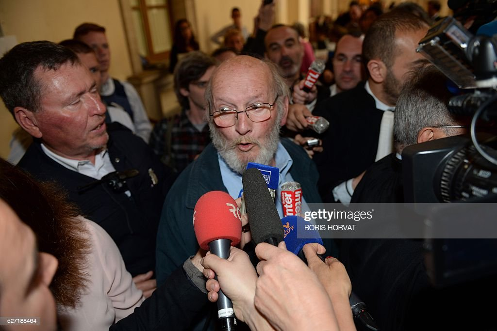 Poly Implant Prothese (PIP) founder Jean-Claude Mas (C) answers journalists as he leaves the courthouse on May 2, 2016, in Aix-en-Provence, following his appeal trial after having been sentenced in an initial trial to four years of imprisonment for allegedly selling faulty breast implants that sparked global health fears. A French appeal court on May 2 upheld a four-year prison sentence for Jean-Claude Mas. HORVAT