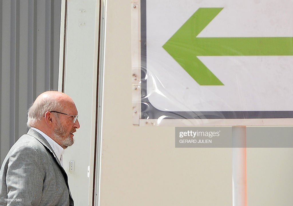 Poly Implant Prothese (PIP) founder Jean-Claude Mas arrives to the courthouse before trial on May 17, 2013 at the Parc Chanot in Marseille, southern France, on the last day of the trial of five managers for allegedly selling faulty breast implants that sparked global health fears. PIP company was shut down on March 2010 and its product banned after it was revealed to have been using non-authorised silicone gel that caused abnormally high rupture rates of its implants. Prosecutors are pushing for a four-year sentence for the faulty breast implant firm founder.