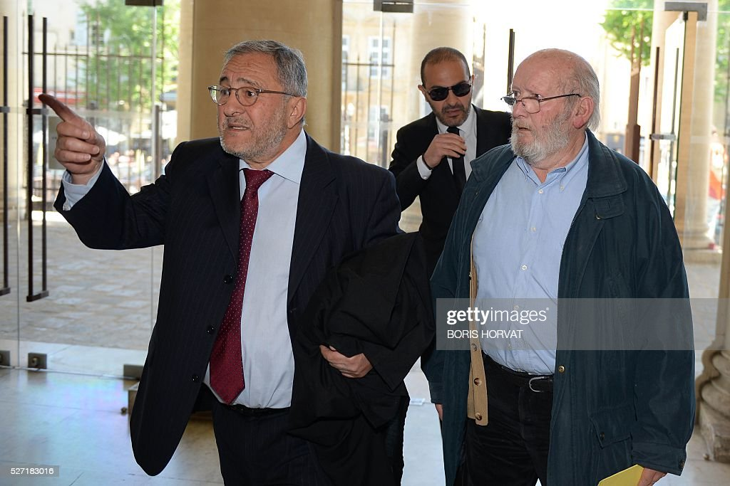 Poly Implant Prothese (PIP) founder Jean-Claude Mas (R) arrives with his layer Yves Haddad (L) outside the courthouse on May 2, 2016 in Aix-en-Provence, prior to his appeal trial, after having been sentenced in an initial trial to four years of imprisonment for allegedly selling faulty breast implants that sparked global health fears. France upholds jail term for Jean-Claude Mas on May 2, 2016. / AFP / BORIS