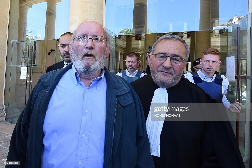 Poly Implant Prothese (PIP) founder Jean-Claude Mas (L) leaves the courthouse with his lawyer Yves Haddad (R) on May 2, 2016, in Aix-en-Provence, following his appeal trial after having been sentenced in an initial trial to four years of imprisonment for allegedly selling faulty breast implants that sparked global health fears. A French appeal court on May 2 upheld a four-year prison sentence for Jean-Claude Mas. HORVAT