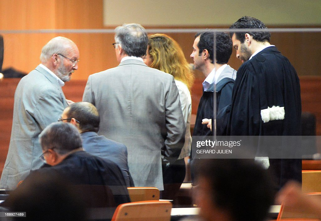 Poly Implant Prothese (PIP) founder Jean-Claude Mas (L) speaks with journalists and lawyers in the courthouse before trial on May 17, 2013 at the Parc Chanot in Marseille, southern France, on the last day of the trial of five managers for allegedly selling faulty breast implants that sparked global health fears. PIP company was shut down on March 2010 and its product banned after it was revealed to have been using non-authorised silicone gel that caused abnormally high rupture rates of its implants. Prosecutors are pushing for a four-year sentence for the faulty breast implant firm founder.