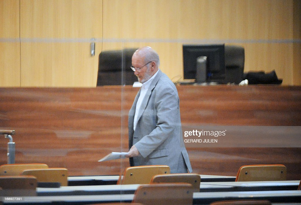Poly Implant Prothese (PIP) founder Jean-Claude Mas stands in the courthouse before trial on May 17, 2013 at the Parc Chanot in Marseille, southern France, on the last day of the trial of five managers for allegedly selling faulty breast implants that sparked global health fears. PIP company was shut down on March 2010 and its product banned after it was revealed to have been using non-authorised silicone gel that caused abnormally high rupture rates of its implants. Prosecutors are pushing for a four-year sentence for the faulty breast implant firm founder.