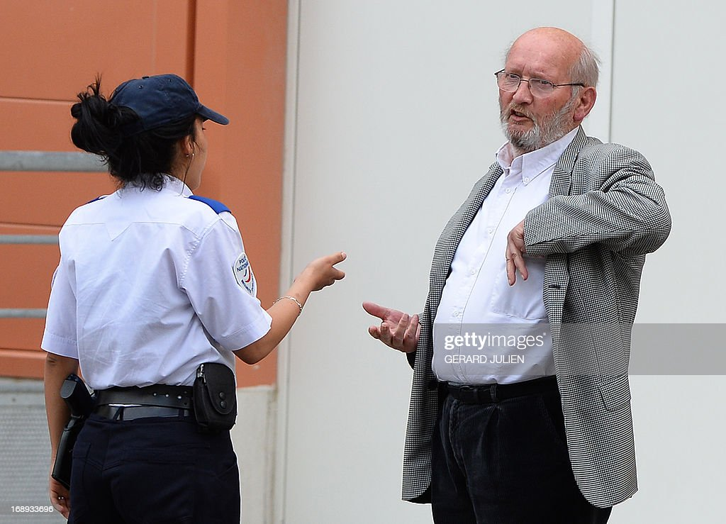 Poly Implant Prothese (PIP) founder Jean-Claude Mas (R) talks with French police woman outside the courthouse after his trial on May 17, 2013 at the Parc Chanot in Marseille, southern France, on the last day of the trial of five managers for allegedly selling faulty breast implants that sparked global health fears. PIP company was shut down on March 2010 and its product banned after it was revealed to have been using non-authorised silicone gel that caused abnormally high rupture rates of its implants. Prosecutors are pushing for a four-year sentence for the faulty breast implant firm founder.
