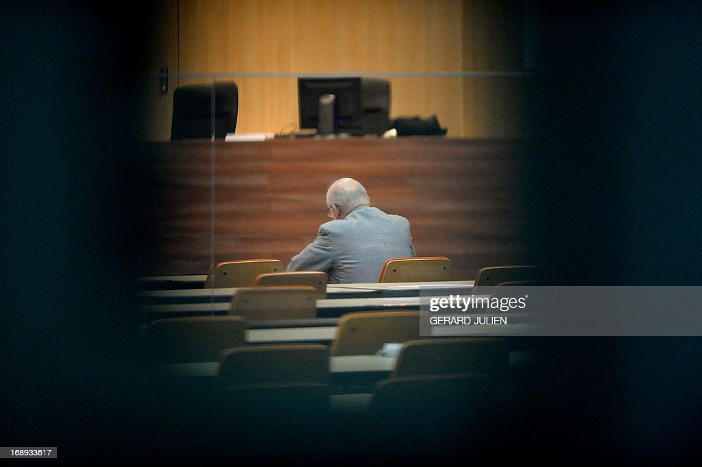 Poly Implant Prothese (PIP) founder Jean-Claude Mas waits in the courthouse trial on May 17, 2013 at the Parc Chanot in Marseille, southern France, on the last day of the trial of five managers for allegedly selling faulty breast implants that sparked global health fears. PIP company was shut down on March 2010 and its product banned after it was revealed to have been using non-authorised silicone gel that caused abnormally high rupture rates of its implants. Prosecutors are pushing for a four-year sentence for the faulty breast implant firm founder.