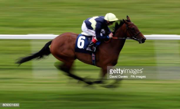 Polygon ridden by Martin Dwyer wins the Download The Blue Square App Maiden Fillies' Stakes during the SIA Charity Day at Newbury Racecourse