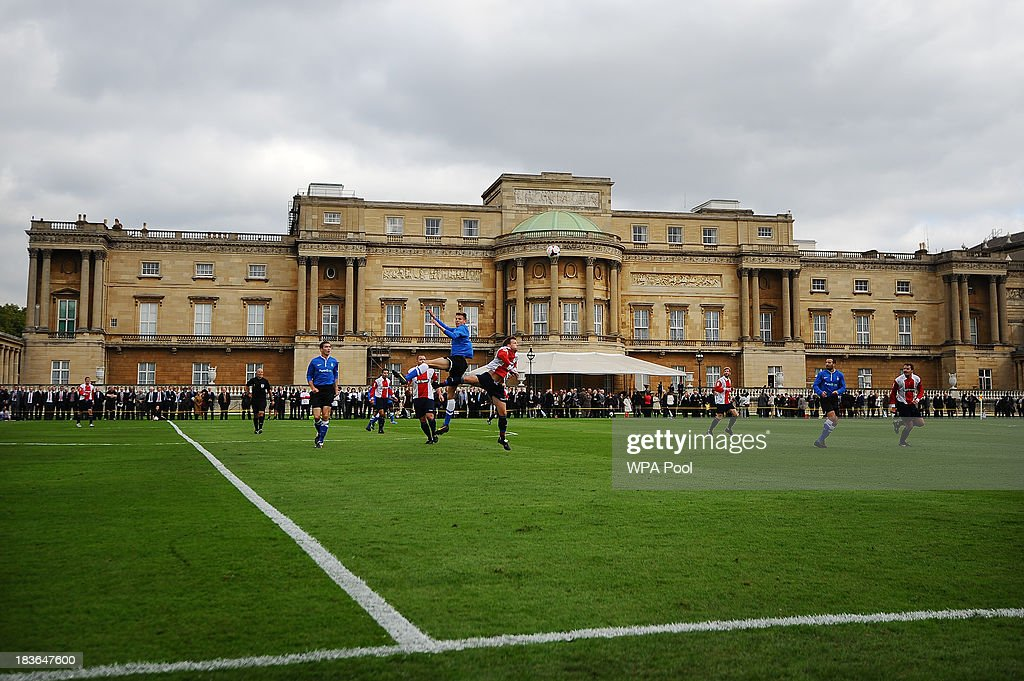 Polytechnic FC (in blue) play Civil Service FC in a Southern Amateur League football match in the grounds of Buckingham Palace to mark the Football Association's 150th anniversary, on October 7, 2013 in London, England. The President of the Football Association, Prince William, Duke of Cambridge, will host the football match between Civil Service FC and Polytechnic FC, and will also host a reception to celebrate The FA's 150 grassroot heroes.