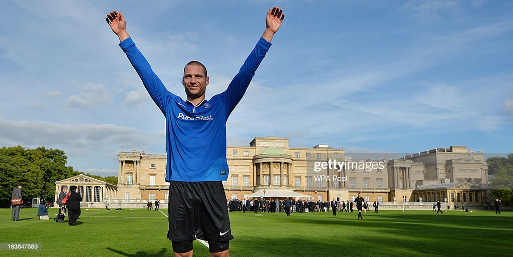 Polytechnic FC player Bojan Jelovac celebrates following the game after scoring the first goal against Civil Service FC in a Southern Amateur League football match in the grounds of Buckingham Palace to mark the Football Association's 150th anniversary, on October 7, 2013 in London, England. The President of the Football Association, Prince William, Duke of Cambridge, will host the football match between Civil Service FC and Polytechnic FC, and will also host a reception to celebrate The FA's 150 grassroot heroes.