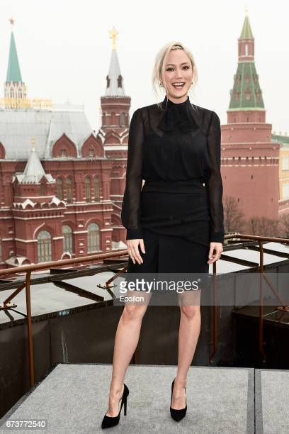 Pom Klementieff poses to photographers before screening of 'Guardians of the Galaxy Vol 2' with Kremlin on background in Four Seasons hotel on April...
