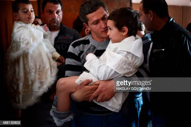 A Pomak man comforts his prior to circumcision during a mass circumcision ceremony for young boys in the village of Draginovo some 180km southeast of...