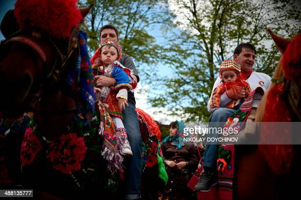 A Pomak men ride horses with their sons during a mass circumcision ceremony for young boys in the village of Draginovo some 180km southeast of Sofia...