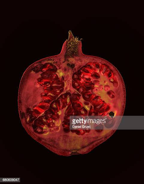 A pomegranate cut into a thin slice