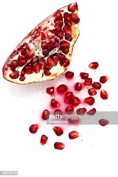 Pomegranate fruit cut in half with seeds
