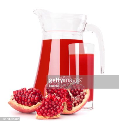 Pomegranate fruit juice in glass pitcher : Stock Photo