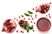 Pomegranate juice with pomegranate isolated on a white background top view