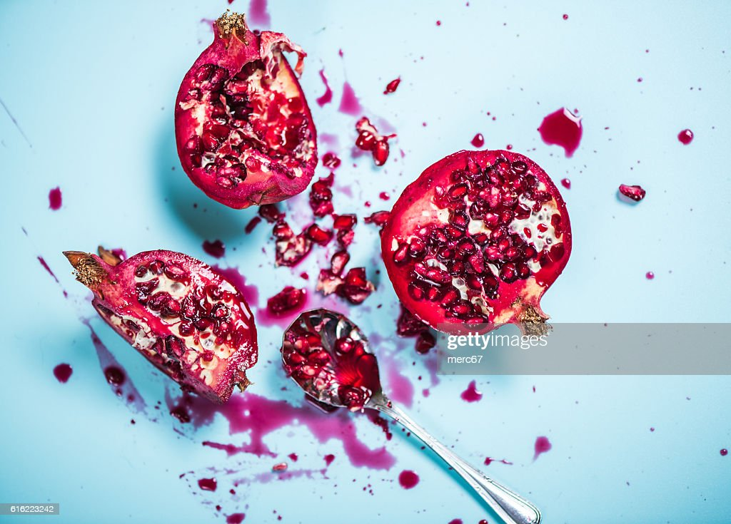 Pomegranate mess with seeds and juice : Stock Photo