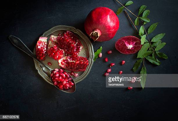 Pomegranate on black textured background.