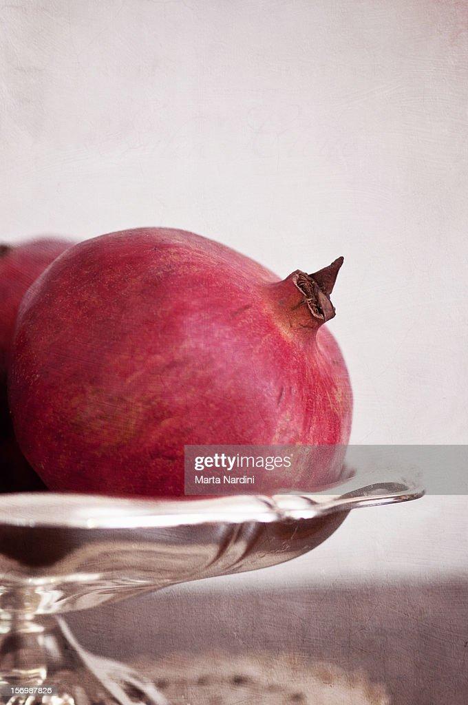 Pomegranate on silver tray : Stock Photo