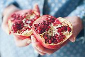 woman holding pomegranate