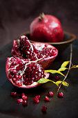Pomegranate still life with low key lighting