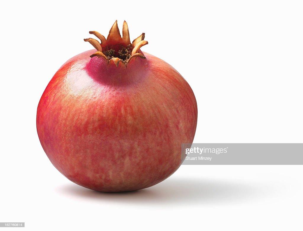 Pomegranate tilted on white background