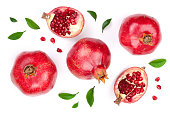 pomegranate with leaves isolated on white background. Top view. Flat lay pattern.