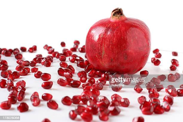 Pomegranite with Scattered Seeds