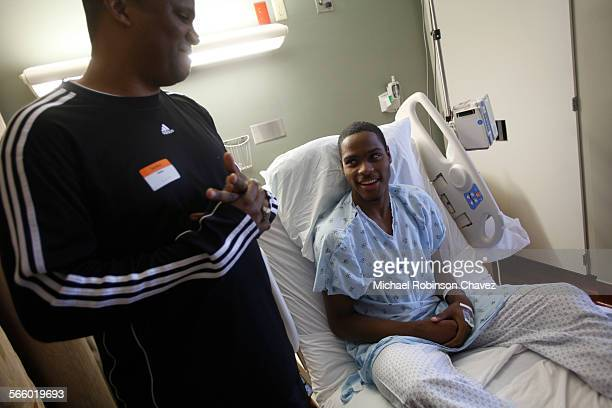 Pomona CA December 1 2010 Xavier Jones right collapsed into cardiac arrest during basketball practice at La Verne Lutheran High School He was...