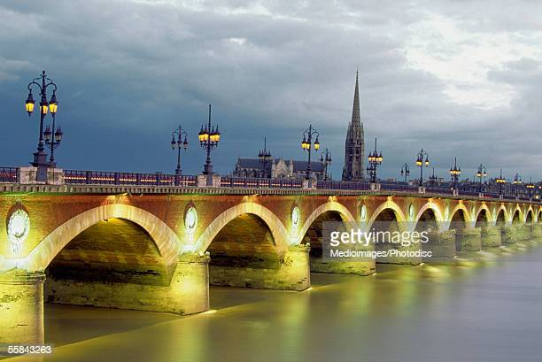 Pont de Pierre Bridge over Gironde River at dusk, Bordeaux, France