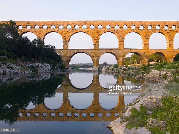 Pont du Gard reflected in River Gardon.