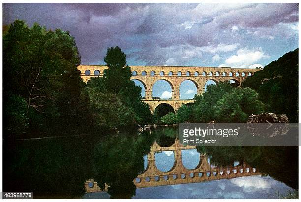 Pont du Gard Roman aqueduct Nimes France This Roman aqueduct was built in c18 BC No cement was used in its construction A print from Places a volume...