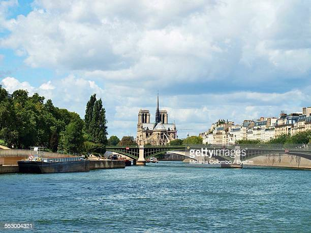 Pont Notre-Dame Over River Seine Against Cloudy Sky