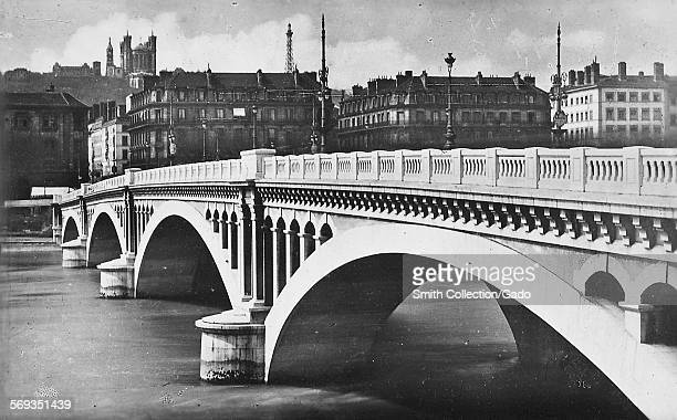 Pont Wilson the large 20th century bridge over the river Saone and the view to the Basilica de Fourviere in the old city Lyon France 1936