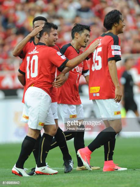 Ponte of Reds Legends celebrates scoring his team's first goal during the Keita Suzuki testimonial match between Reds Legends and Blue Friends at...