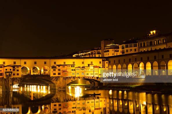 Ponte Vecchio bridge over the River Arno at night Florence Italy