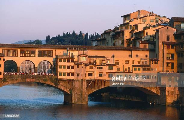 Ponte Vecchio over Arno River at sunset.