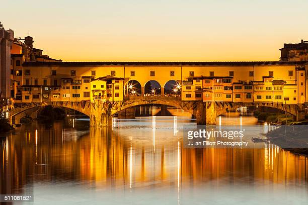 Ponte Vecchio over the river Arno at sunset