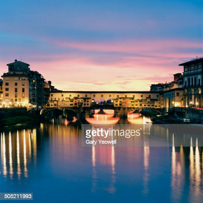 Ponte Vecchio reflected in River Arno, Florence